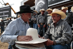 Vern Elliott, Clay Elliott's father, of Gold Springs Custom Hats fits PRCA Announcer Bob Tallman for a custom hat. The Hardgrass Bronc Match rodeo committee and Berry Creek Ag society presented Bob with the hat before the start of the event.