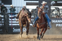 Gary Rempel works to set a ranch bronc horse for an old time demonstration at the start of the Hardgrass Bronc Match.
